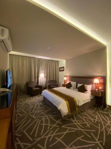 Cama ou camas em um quarto em Desert Rose