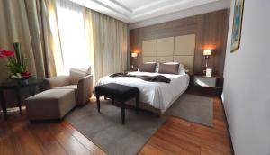 A bed or beds in a room at Le Palace d'Anfa