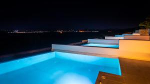 The swimming pool at or near Hotel Milos Resort