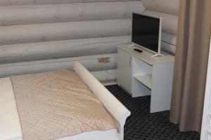 Кровать или кровати в номере Гелион Парк Отель