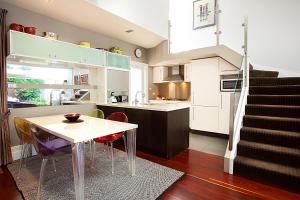 A kitchen or kitchenette at Striking open plan home in quiet inner-city area