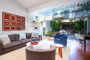 A seating area at Striking open plan home in quiet inner-city area