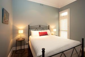 A bed or beds in a room at Striking open plan home in quiet inner-city area