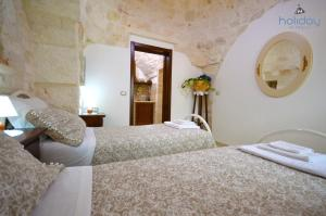 A bed or beds in a room at I Trulli Di Nonno Giovanni