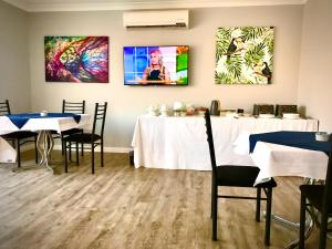 A restaurant or other place to eat at Marco Polo Taree