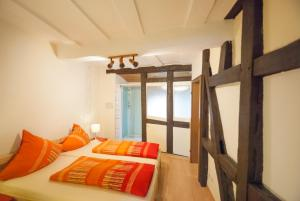 A bed or beds in a room at Alte Weinstube Burg Eltz