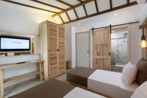 Кровать или кровати в номере Club Tuana Fethiye - All Inclusive