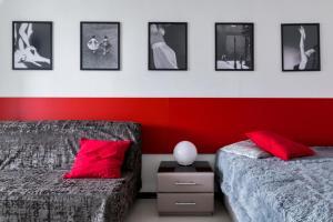 Кровать или кровати в номере Rental SPb Studios Varshavskaya