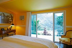 Postel nebo postele na pokoji v ubytování La Suite by Dussol