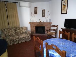 A seating area at Hospederia y Aptos Casa de las Piedras