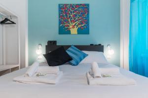 Letto o letti in una camera di Colorful Gem in Testaccio