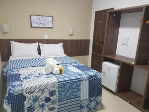 A bed or beds in a room at Pousada Gamela do Maragogi