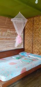 Cama o camas de una habitación en Batuan Hammock Hostel