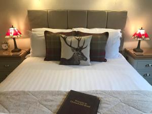 A bed or beds in a room at Orchard Hill Hotel