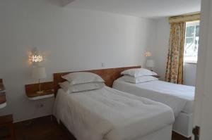 Een bed of bedden in een kamer bij Hotel Vasco Da Gama