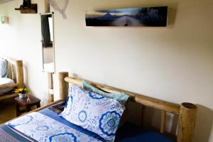 A bed or beds in a room at Karungi Camp