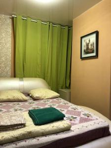 Кровать или кровати в номере Апартаменты-Студио 15 кв/м