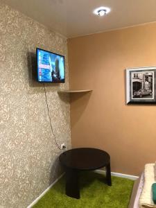 Телевизор и/или развлекательный центр в Апартаменты-Студио 15 кв/м
