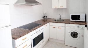 Una cocina o zona de cocina en Apartaments Can Xel