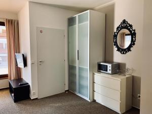 Televízia a/alebo spoločenská miestnosť v ubytovaní Apartmany Jasna Chopok
