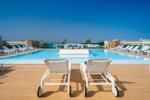 The swimming pool at or near Le Dune Suite Hotel