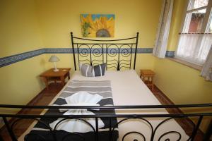 Ein Bett oder Betten in einem Zimmer der Unterkunft Landhaus Alt Reddevitz