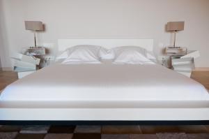 Un ou plusieurs lits dans un hébergement de l'établissement La Villa Calvi