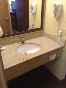 A bathroom at AmericInn by Wyndham Newton