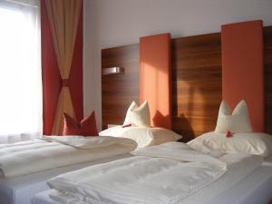 Ein Bett oder Betten in einem Zimmer der Unterkunft Hotel Gasthof Gaum