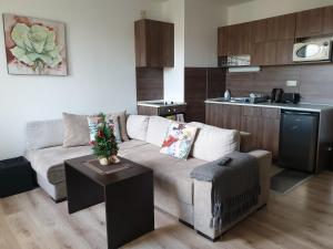 A seating area at Royal Bansko Aparthotel 206D