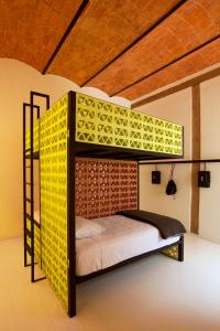 A bunk bed or bunk beds in a room at Downtown Beds