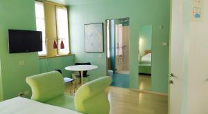 A seating area at Petronilla - Hotel In Bergamo