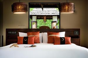 A bed or beds in a room at The Vijitt Resort Phuket