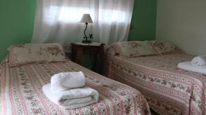 Una cama o camas en una habitación de Hotel Albert