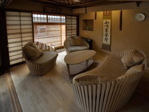 A seating area at Traditional Kyoto Inn serving Kyoto cuisine IZYASU - Former Ryokan Izuyasui