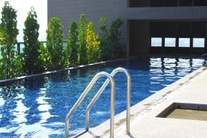 The swimming pool at or near Maison de Chine Taichung (Pin Chen)