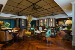A restaurant or other place to eat at Eastern & Oriental Hotel