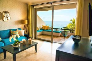 Zona de estar de One Bedroom Ocean View Suite In Medano Beach