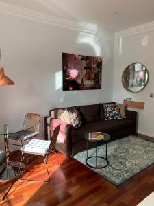 Zona de estar de I19 - One Bedroom Apartment