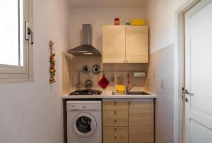 A kitchen or kitchenette at Apartment Storico