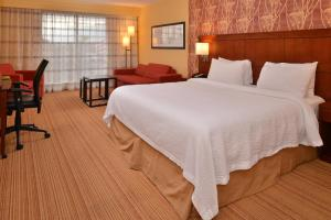 A bed or beds in a room at Courtyard Mt. Holly Westampton