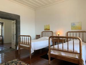 Ein Bett oder Betten in einem Zimmer der Unterkunft Casa das Barcas