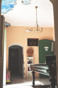 A television and/or entertainment center at City-In Hostel B&B