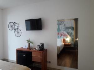 A television and/or entertainment center at La Vela Boutique Hotel