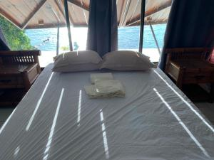 Cama ou camas em um quarto em Magnifique maison bord de lagon