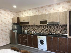 A cozinha ou cozinha compacta de Intourist Villa