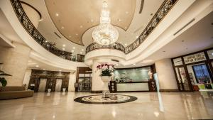 The lobby or reception area at Super Hotel Candle