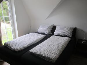 A bed or beds in a room at Schneekäppchen 2