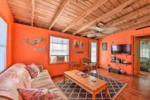 A seating area at Colorful Cottage - 2 Blocks to Surfside Beach!