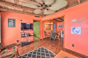 A television and/or entertainment center at Colorful Cottage - 2 Blocks to Surfside Beach!